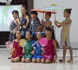 "The students from Qiuzhi Primary school perform their ""Silk Road"" dance at the 9ISS opening ceremony"