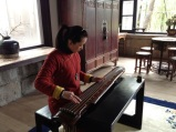 A guqin player at Jin Ze