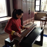 A guqin player at Jin Ze