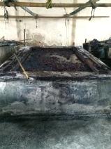 Large indigo vat. Photo courtesy of Amy Putansu.